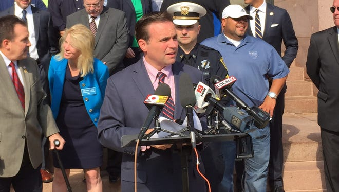 Mayor John Cranley, joined by politicians and union representatives, speaks Thursday at City Hall about his proposal to give city workers raises.