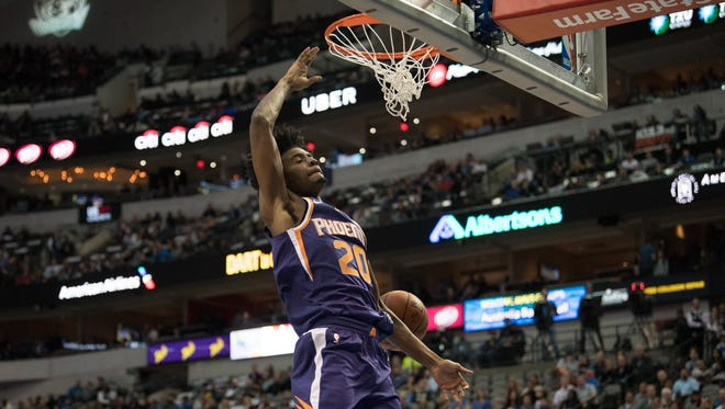 Phoenix Suns forward Josh Jackson (20) dunks the ball against the Dallas Mavericks during the first quarter at American Airlines Center.