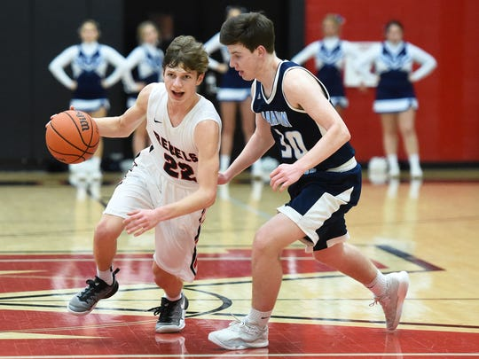 Maryville's Joe Anderson, left, dribble down the court against Hardin Valley's Tristen Waite on Tuesday Maryville High School.