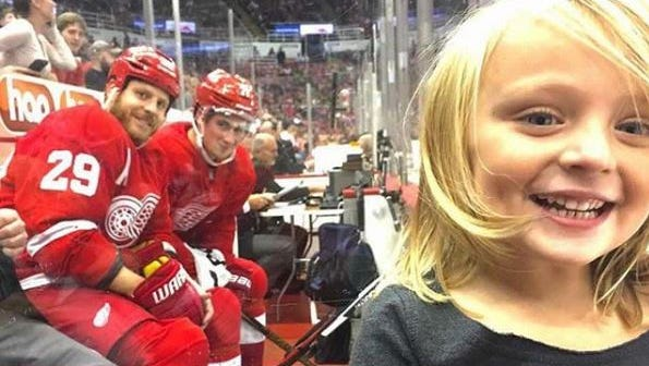 Red Wings players photobomb a small girl.