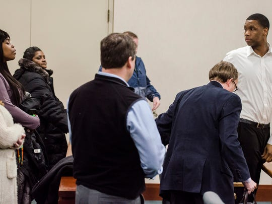Right, Chavis Murphy looks to his family and friends after a jury found him guilty of second-degree murder Monday night, Feb. 12, 2018, at Vermont Superior Court in Burlington. Murphy was accused of shooting and killing 28-year-old Obafemi Adedapo in December of 2015 on Church Street.
