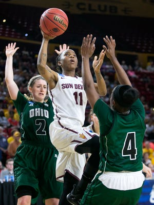 ASU guard Peace Amukamara puts up a shot as Ohio's Mariah Byard (2) and Kiyanna Black (4) defend during the first half of the first round game of the NCAA Division I Women's Basketball Championship tournament at Wells Fargo Arena in Tempe, Ariz., on Saturday, March 21, 2015.