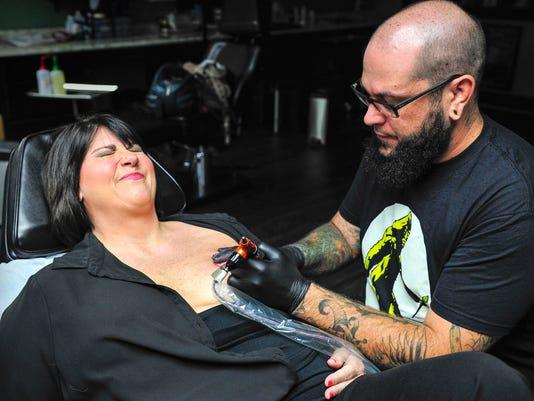 nas-tattoo artist