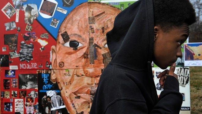 LeDarious Barlow, 15, was one of the artists who worked on a Nashville mural challenging stereotypes of young black men.