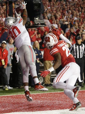 Ohio State receiver Noah Brown catches the game-winning touchdown while being covered by Wisconsin cornerback Derrick Tindal last Saturday in Madison.