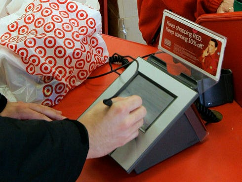 In a 2008 file photo, a customer signs his credit card receipt at a Target store in Tallahassee, Fla.