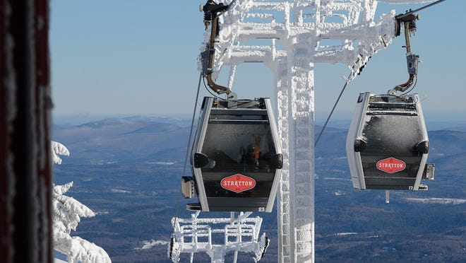 Modern view of gondolas atop Stratton Mountain.