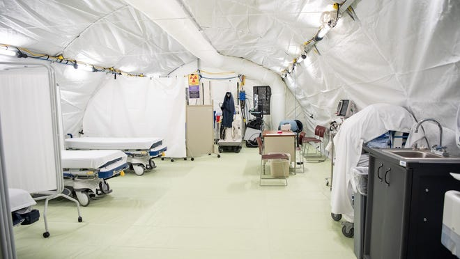 File - Doylestown Health's emergency response tent opened Monday, March 30, 2020. The temporary facility has room to treat a combined 20 patients at a time between the primary care provider and emergency department sections of the tent.