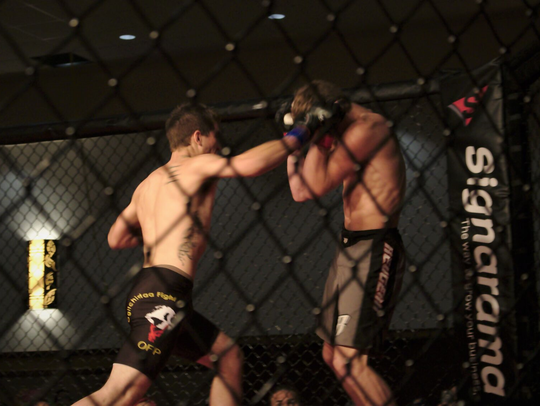 Gary Konkol lands a punch during one of his amateur