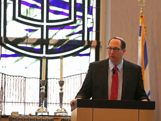 Rabbi Adam Miller, of Temple Shalom, speaks about the importance of remembering the past during the Yom Hashoah: Holocaust Remembrance Day on Sunday,April 23, 2017.