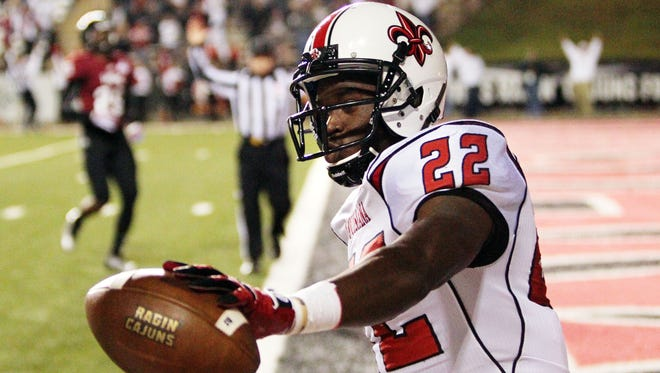 UL running back Elijah McGuire after scoring one of his many Cajun touchdowns.