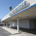 The shuttered Mac Magruder dealership on South Palm Canyon Drive. Palm Springs is asking a judge to force the owners to repair the building or tear it down.