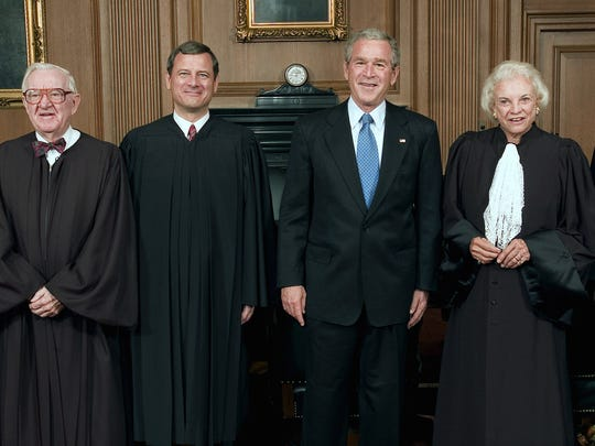 President George W. Bush (second from right) poses