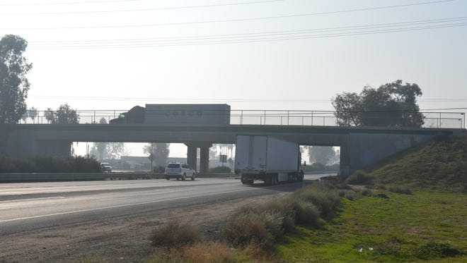 Trucks travel near the Paige Avenue overpass. A Pilot/Flying J truck stop is being proposed for the area.