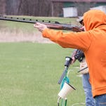 Members of the Harper Creek Clay Target Club shoot a round of trap at Centerline Gun Club Thursday.