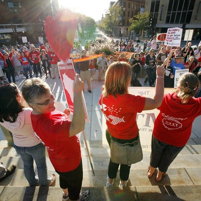 Teachers rally against Act 10 at the State Capitol.