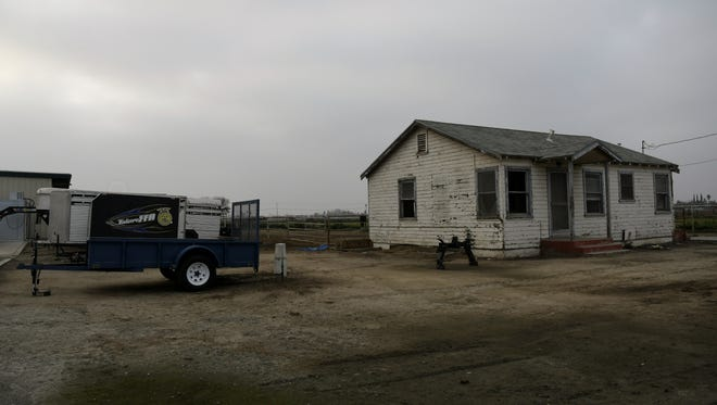 A dilapidated home on the Tulare High School Farm sits on the site where a new classroom and administration building will be constructed.