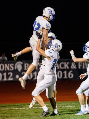 Teammates hoist Brookfield Central junior Joey Cleary (22) in celebration after his touchdown reception at the end of the first half against Brookfield East on Friday, Sept. 29, 2017.
