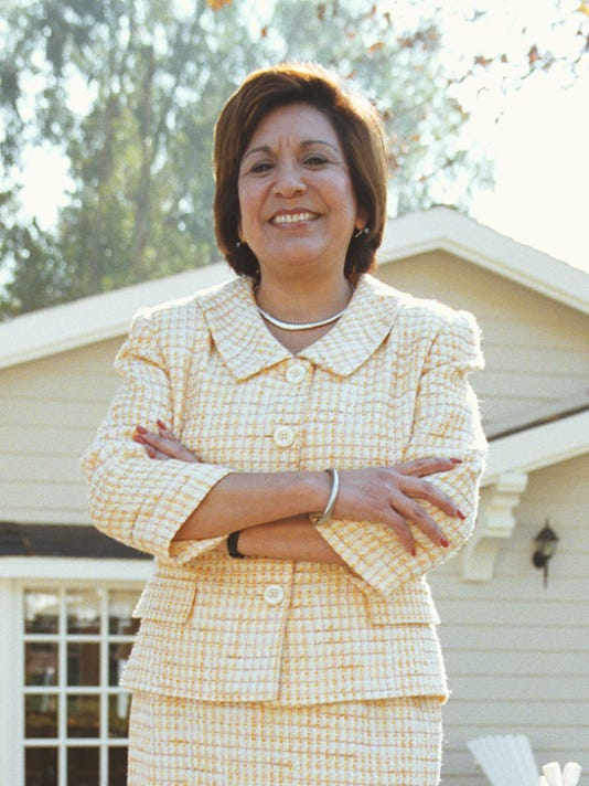 Realtor standing in front of home, portrait