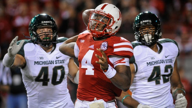Nebraska quarterback Tommy Armstrong Jr. (4) plays against Michigan State during their game at Memorial Stadium on Nov. 16, 2013, in Lincoln, Neb.
