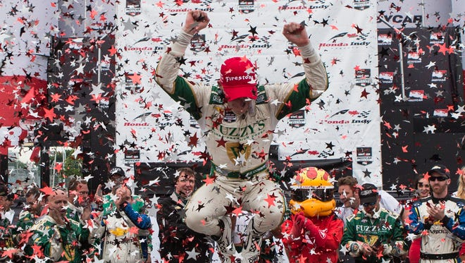 England's Mike Conway leaps out of his car after winning the second race of the Toronto Indy in Toronto.