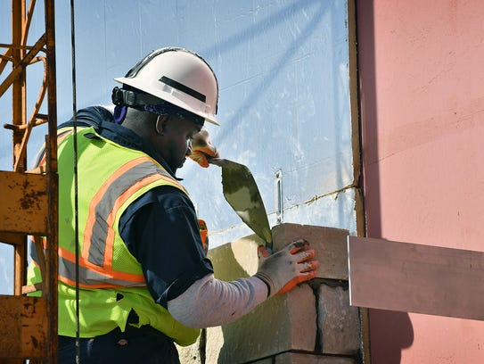 A bricklayer for W.P. Howle works on the $4.8 million