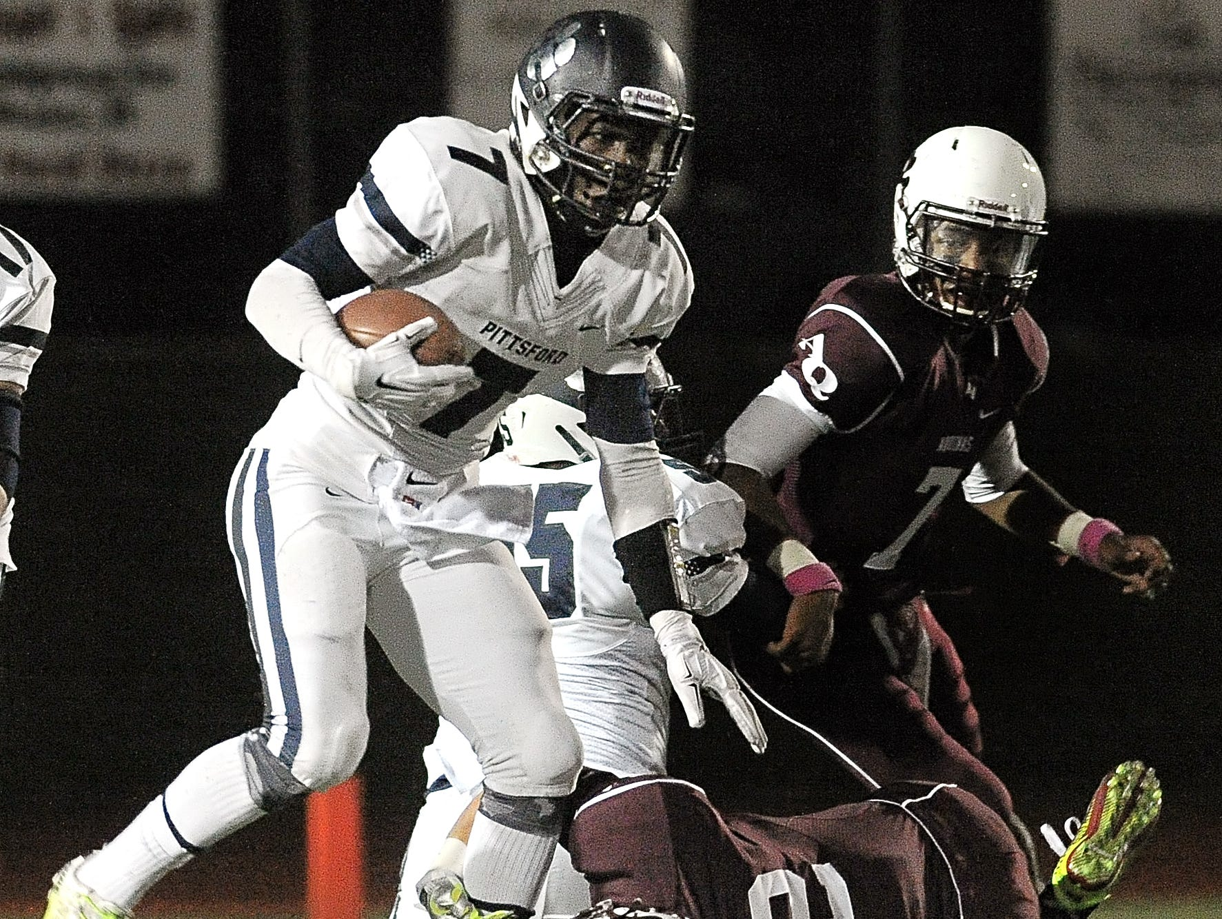 Pittsford's Josh Mack, shown here against Aquinas in 2014, carried a personal-high 49 carries last Friday against Orchard Park.