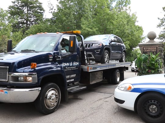 A  vehicle is towed from the Riverside Cemetery on Friday after Assemblyman Bill Nojay committed suicide there earlier in the day.