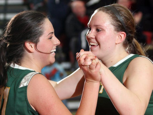 St. Mark's Cassidy Flanigan (left) is congratulated by Kaitlynn Wolff after she drew a foul while sinking a fourth quarter basket against William Penn in a first round matchup in the DIAA state high school tournament, Tuesday, Feb. 25, 2014 at William Penn High School.