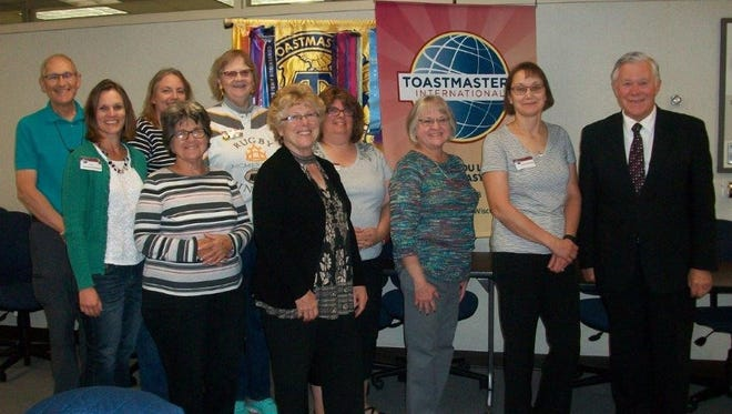 Fond du Lac Toastmasters Club No. 498 poses in front of the Toastmasters' banners at the Oct. 9 meeting. Pictured are, front row, from left: Kari Jacobsen-Gagnow, Connie Betz and Valerie Hunt; back row: Clark Koechel, Michele Hofmaier, Linda DeClute, Jenny Woosencraft, Katherine Mattsen, Sharon Secord and Paul Hunt.