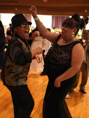 Michelle Williams and her son Todd, 11, share a dance and some laughs Saturday at the Take Your Mom to Prom event.