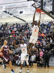 Belleville's Gabe Brown goes up for a dunk during a