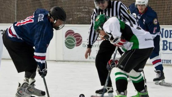 Retired Army Captain Mark Little faces off against Brick Stars Evan Yasser at the 2014 Winter Challenge game.