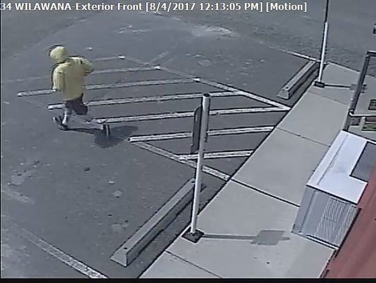 Security footage of an armed robbery incident that