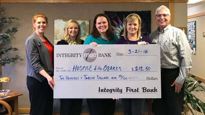 """Giving back to the community is a primary focus of Integrity First Bank's Employee Relations Committee. Each month, the committee meets to discuss ideas about partnering their IFB team with the community through volunteer efforts. For the New Year, members of the committee organized a """"Choose to Lose"""" weight-loss challenge and fundraiser. Participants paid a fee to enter the 12-week challenge. Total funds collected were then split between the person who lost the highest percentage of their beginning weight and a local charity of their choice. Pepper Morrison, Integrity First Bank Tech Support Specialist and winner of the first 12-week challenge presented a check to Hospice of the Ozarks in the amount of $212.50. """"The compassion and care Hospice of the Ozarks provides to their patients is remarkable.The end of life is a very difficult time, and it is important that people receive the necessary support to get through.I am proud to support their hard work and dedication,"""" said Morrison. Participating in the donation were: (from left)Jaren Beavers, Shawna Rosson,and Pepper Morrison with Integrity First Bank; Elaine Essary, Outreach and Development Coordinator; and Greg Wood, Director, Hospice of the Ozarks."""