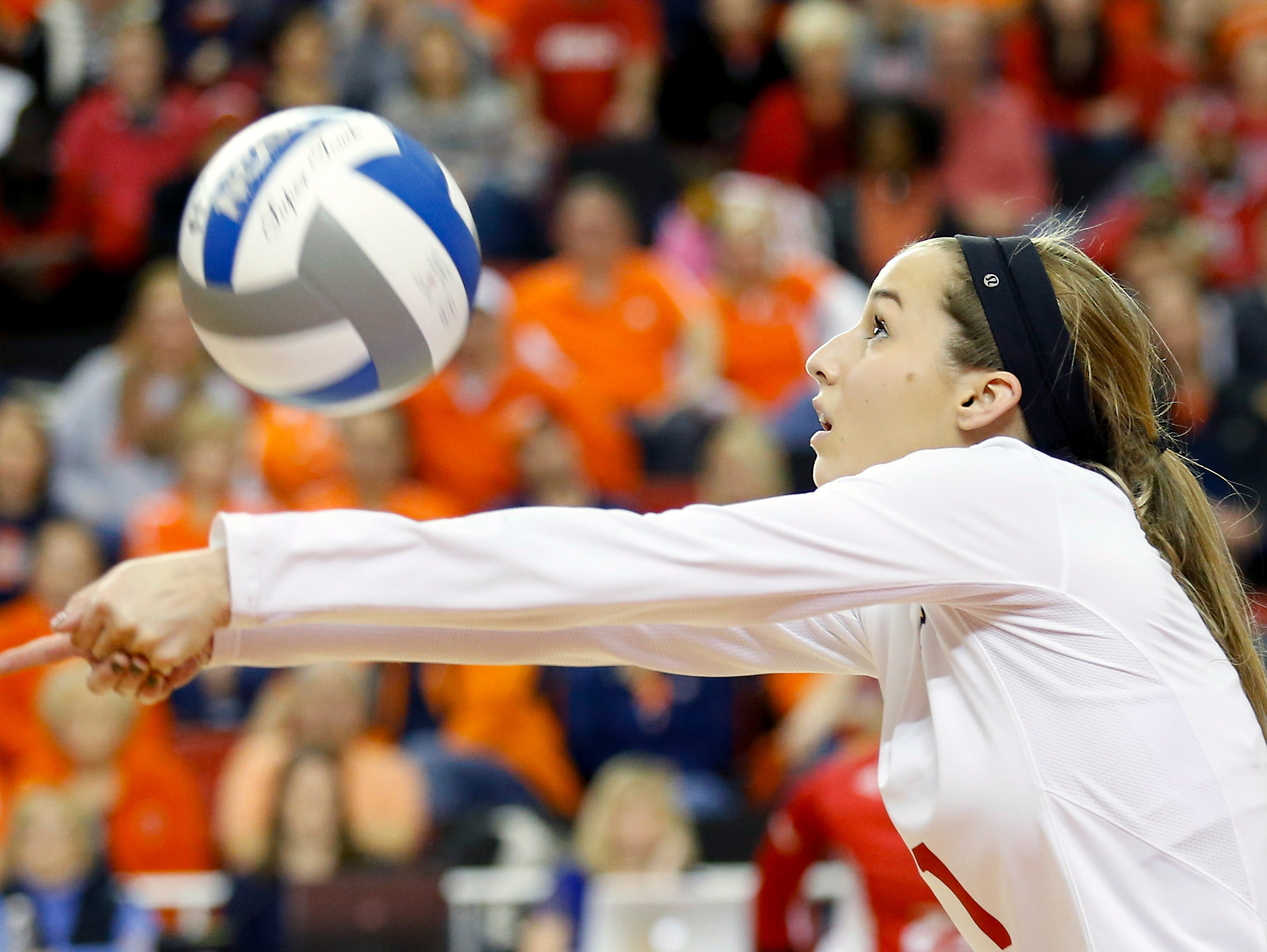 Louisville's Molly Sauer with the dig. Dec. 5, 2015