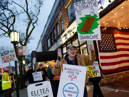 FILE - Gary Dean, 58, of Wolverine Lake, marches on Old Woodward Avenue with protesters rallying in support of Affordable Care, Medicaid and Medicare in downtown Birmingham.