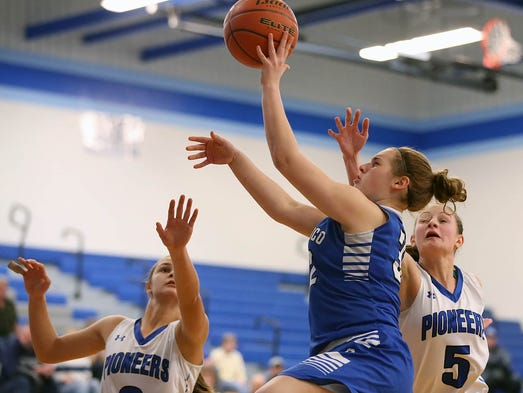 Cocalico's Maddie Bock (32) goes to the hoop against