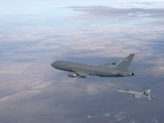 The KC-46 Pegasus tanker refuels an F/A-18 aircraft.