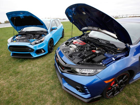The 2017 Honda Civic TypeR, right, versus the 2016 Ford Focus RS in a head-to-head showdown, seen here at the Autobahn Country Club in Joliet, on Friday, Oct. 27, 2017.
