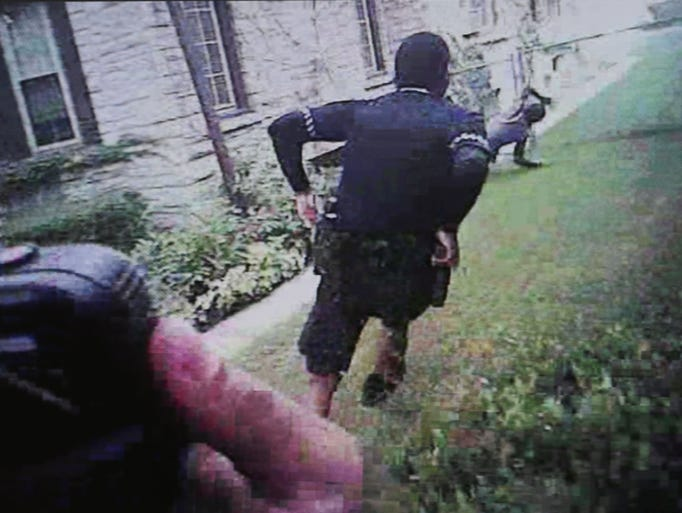 In still images from a Milwaukee police officer body