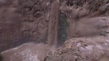 Flooding at the Grand Canyon's Havasupai Falls area that forced officials to evacuate tourists, in a photo Thursday July 12, 2018, posted to Facebook