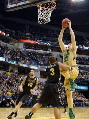 Notre Dame  forward Martinas Geben (right) dunks against Purdue   guard R.J. Thompson (3) during the Crossroads Classic at Bankers Life Fieldhouse on Dec. 20, 2014. The Irish are counting on Geben to start this season as a junior.
