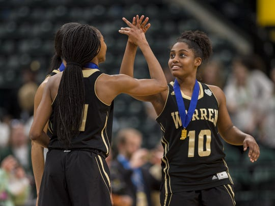 Warren Central High School junior guard Shaila Beeler (10) and sophomore guard K'ja Talley (21) celebrate the team's victory over Zionsville High School in the 43rd Annual IHSAA Girls Basketball State Finals class 4A championship game, Saturday, February 24, 2018, at Bankers Life Fieldhouse in Indianapolis. Warren Central won 50-46.