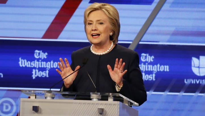 In this photo taken March 9, 2016, Democratic presidential candidate, Hillary Clinton speaks during the Democratic presidential debate in Miami, Fla.