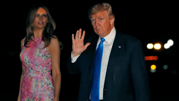 President Donald Trump waves as he walks with first