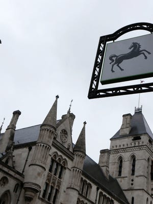 A Lloyds Bank hangs outside a branch in central London in March 2014.