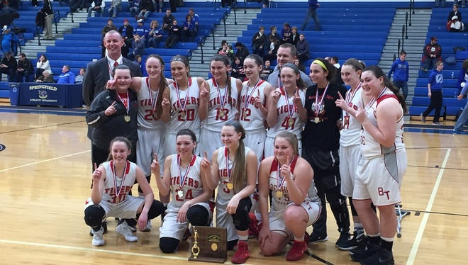 The Bethel-Tate High School girls' basketball team celebrates its first district championship with a 44-39 win over Miami East.