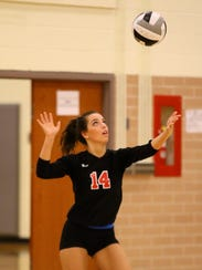Pleasant's Morgan Haas serves the ball during a 3-1 victory over Northmor for a Division III district volleyball championship Saturday.