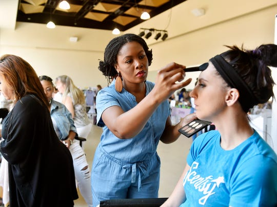 PRIMP Agency makeup artist Kiuana Santiago applies makeup for Scentsy consultant Kirstynn Seiple during the Ladies Who Primp Women's Expo Saturday, July 22, 2017, at the Appell Center for the Performing Arts' studio in York. The expo is the ninth organized by Shá Summerlin, owner/creative director of PRIMP Agency, and featured about 20 local vendors selling cosmetics, jewelry, clothes and other products and services.